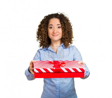 Smiling business woman holding gift box in hands giving someone present