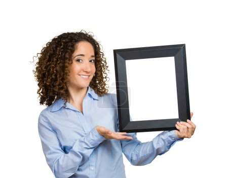 Smiling business woman holding, presenting black photo frame