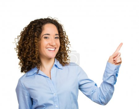Woman pointing presenting at copy space