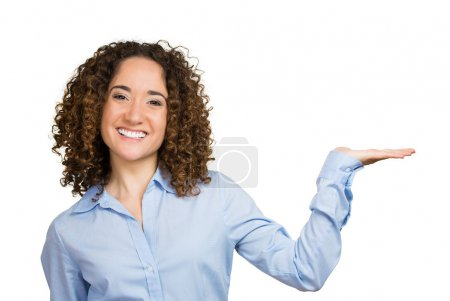 Photo pour Closeup portrait happy pretty confident young smiling woman gesturing, presenting blank copy space with palm up, pointing isolated on white background. Positive human emotion signs symbol, facial expression feelings. Advertisement concept - image libre de droit