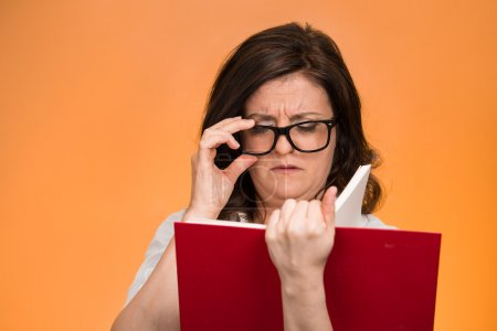 Woman having difficulties seeing text because of vision problems