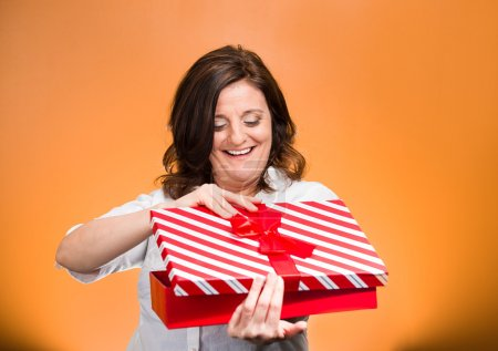 Woman about to open, unwrap red birthday gift box