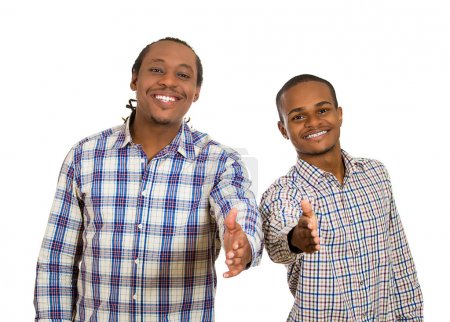 Two young men giving hand shake