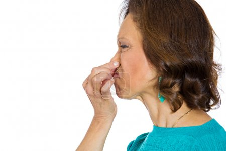 Woman pinches nose bad smell