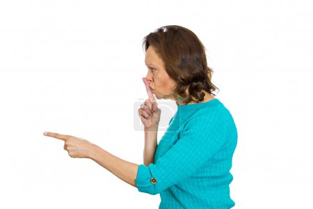 Senior woman placing finger hand on lips, shh gesture, quiet silence
