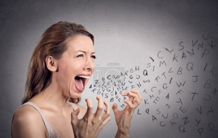 Photo for Side view portrait angry woman screaming, alphabet letters coming out of open mouth, isolated grey wall background. Negative human face expressions, emotion, reaction. Conflict, confrontation concept - Royalty Free Image