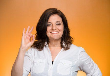 excited woman giving OK sign