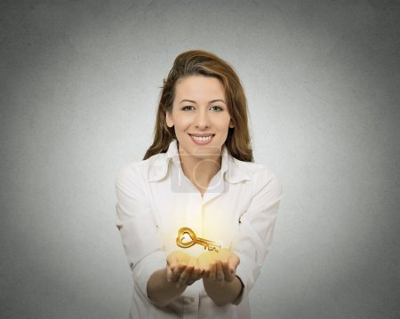 Photo for Portrait happy woman, hands holding offering new key to success isolated grey wall background. Positive human emotions, face expression. Successful career, business, opportunity, real estate concept - Royalty Free Image