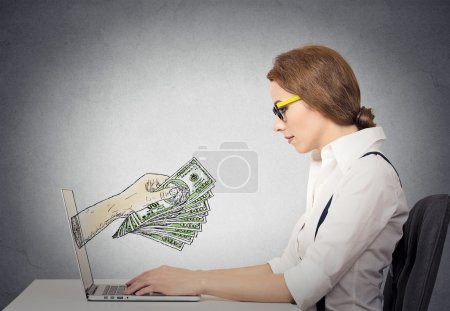 business woman making money working on line on computer