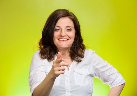 Photo for Closeup portrait mature woman laughing smiling pointing finger at someone, something, isolated on green background. Positive human emotion facial expression feelings, attitude, reaction - Royalty Free Image
