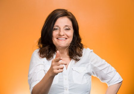 Photo for Closeup portrait mature woman laughing smiling pointing finger at someone, something, isolated on orange background. Positive human emotion facial expression feelings, attitude, reaction - Royalty Free Image