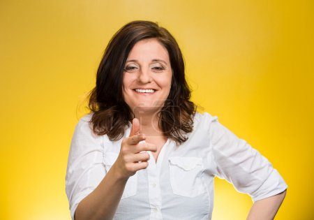 Photo for Closeup portrait mature woman laughing smiling pointing finger at someone, something, isolated on yellow background. Positive human emotion facial expression feelings, attitude, reaction - Royalty Free Image