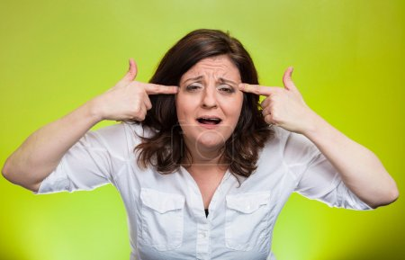 Photo for Closeup portrait angry mad middle aged woman gesturing with fingers against temple asking are you crazy? Isolated green background. Negative human emotions facial expression feeling body language - Royalty Free Image