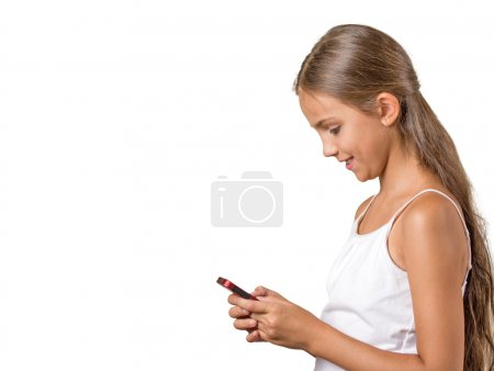 Photo for Side view profile portrait happy, cheerful, teenager girl texting on cell phone isolated white background with copy space. Positive facial expression reaction. Teen sending message from  mobile device - Royalty Free Image
