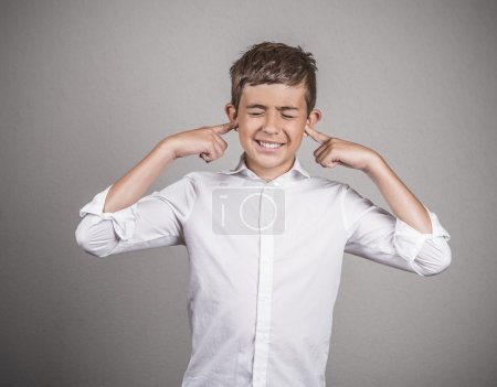 annoyed young man plugging closing ears