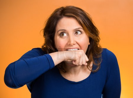 Crazy woman going nuts biting her arm