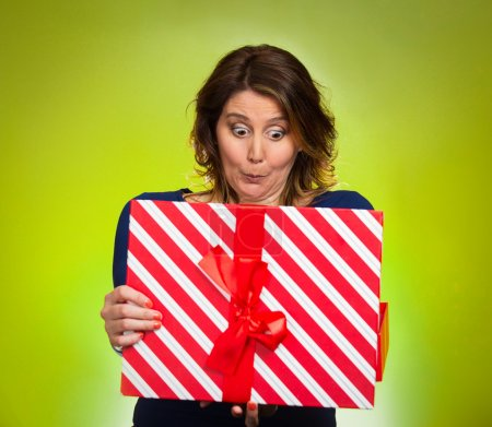 woman opening red gift box, surprised