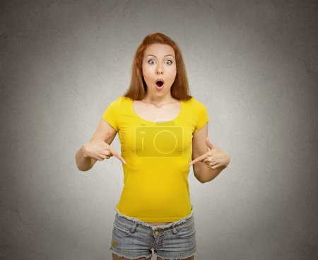 woman pointing at blank copy space of her yellow t-shirt