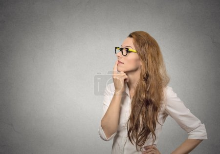 Photo pour Portrait side profile happy beautiful woman thinking looking up isolated grey wall background with copy space. Human face expressions, emotions, feelings, body language, perception - image libre de droit