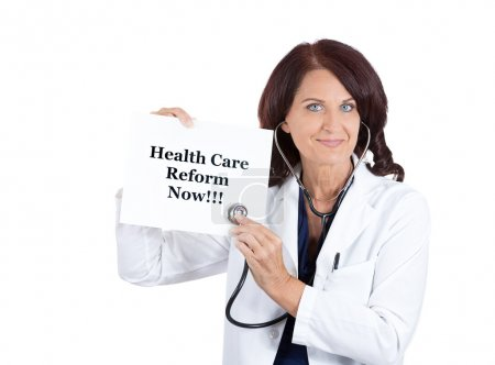 Doctor with stethoscope holding health care reform now sign