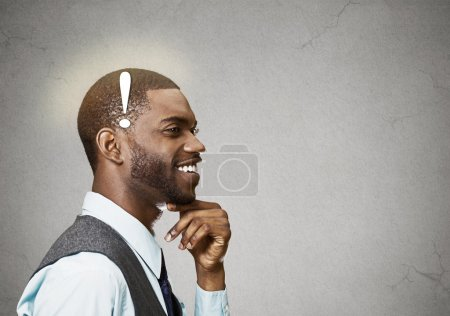 Photo pour Portrait side view profile headshot happy man thinking found solution for problem isolated grey wall background with copy space. Human face expression emotion feeling body language perception iq - image libre de droit