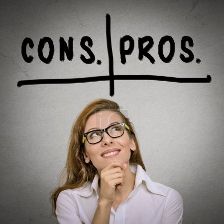 Photo for Pros and cons, for and against argument concept. Thinking young business woman with glasses looking up isolated on grey wall background. Face expression, emotion, feeling, perception, vision, decision - Royalty Free Image