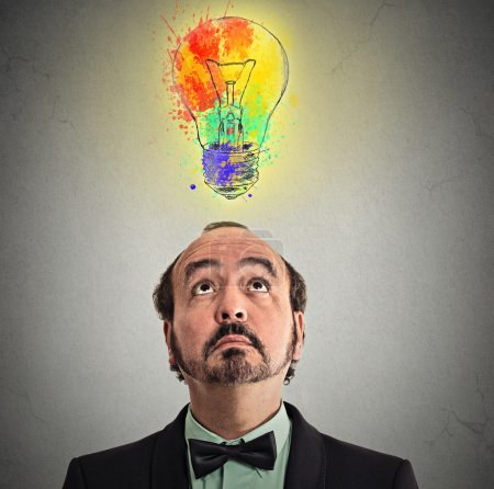 businessman came up with solution answer for problem lightbulb above head