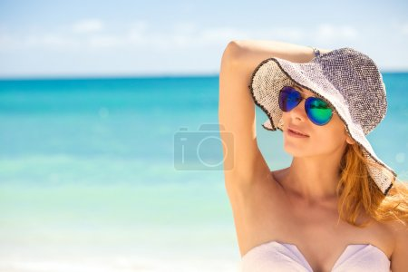 happy young woman on beach, beautiful female enjoying tropical weather