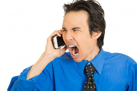 angry young man shouting while on phone