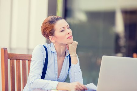 worried stressed business woman working on computer laptop