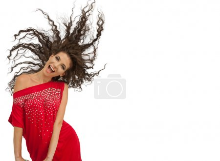 happy laughing playful woman posing in red dress