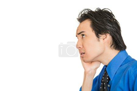 Worried stressed. Closeup side view portrait man, ...