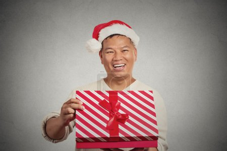 Excited surprised middle aged man opening unwrapping red gift box