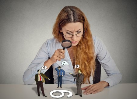 Businesswoman skeptically looking at arguing people through magnifying glass