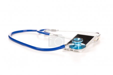 Mobile phone with stethoscope isolated on white background.