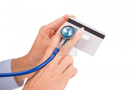 Woman hands holding listening credit card with stethoscope