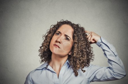 woman scratching head thinking daydreaming