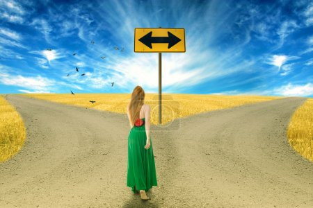 Young woman standing in front of two roads
