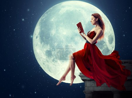 Photo for Cute woman, female reading book, moonlight sky night skyline, night skyline clouds background. Dreamy,  nature landscape screen saver, artistic illustration. Elements of this image furnished by NASA. - Royalty Free Image