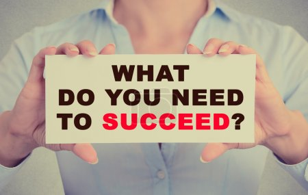 Businesswoman hands holding sign with what do you need to succeed question