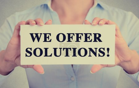 Businesswoman hands holding sign with we offer solutions!