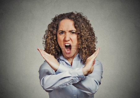 Photo pour Angry screaming young woman making showing stop gesture isolated on grey wall background Negative human emotion facial expression feelings, sign symbol body language, reaction nonverbal communication - image libre de droit