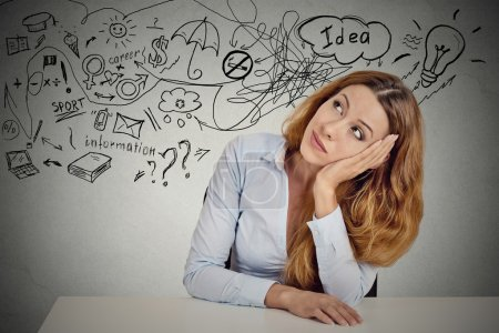 Business woman sitting at table has many ideas thi...