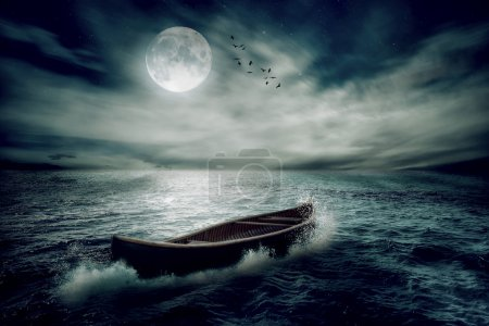 Photo for Boat drifting away in middle ocean after storm without course moonlight sky night skyline clouds background. Nature landscape screen saver. Life hope concept. Elements of this image furnished by NASA - Royalty Free Image
