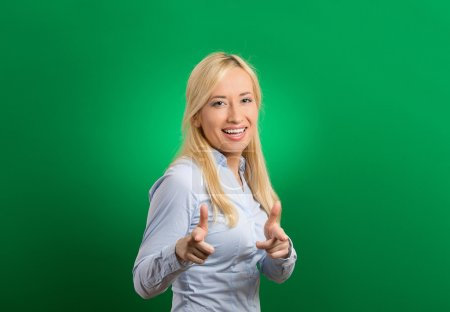 Photo pour Happy woman with two thumbs up guns hand gesture pointing at you camera - image libre de droit