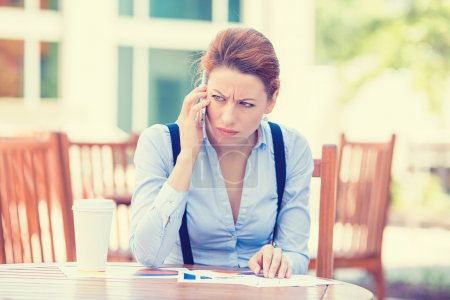 Photo for Portrait unhappy worried middle aged business woman talking on mobile phone isolated outdoors outside corporate office. Negative face expression emotion feelings. Urban life difficulty stress concept - Royalty Free Image