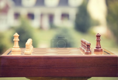 First move over wood chessboard. Real estate sale home savings loans market