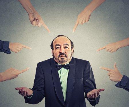 accusation of guilty arrogant businessman who shrugs shoulders