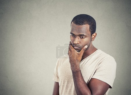 Photo for Portrait sad, depressed, worried young man looking down isolated on grey wall background. Human face expressions, emotion, feelings, reaction, life perception - Royalty Free Image