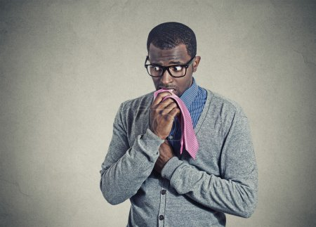Photo for Portrait geeky nervous anxious businessman bitting chewing his tie - Royalty Free Image